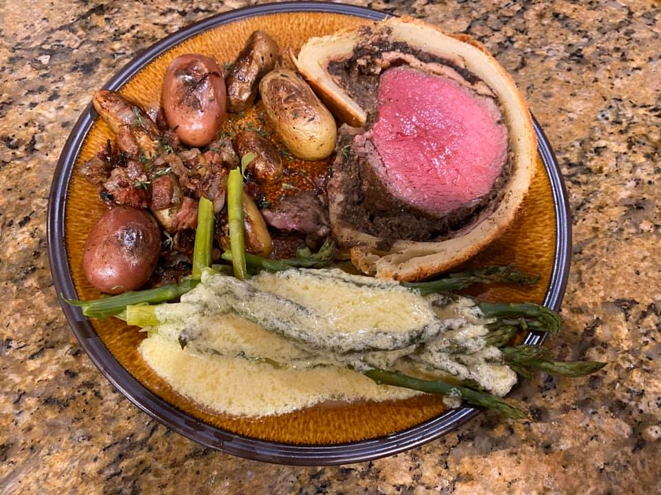 Christmas dinner: marrowbones with toast and Beef Wellington mixe