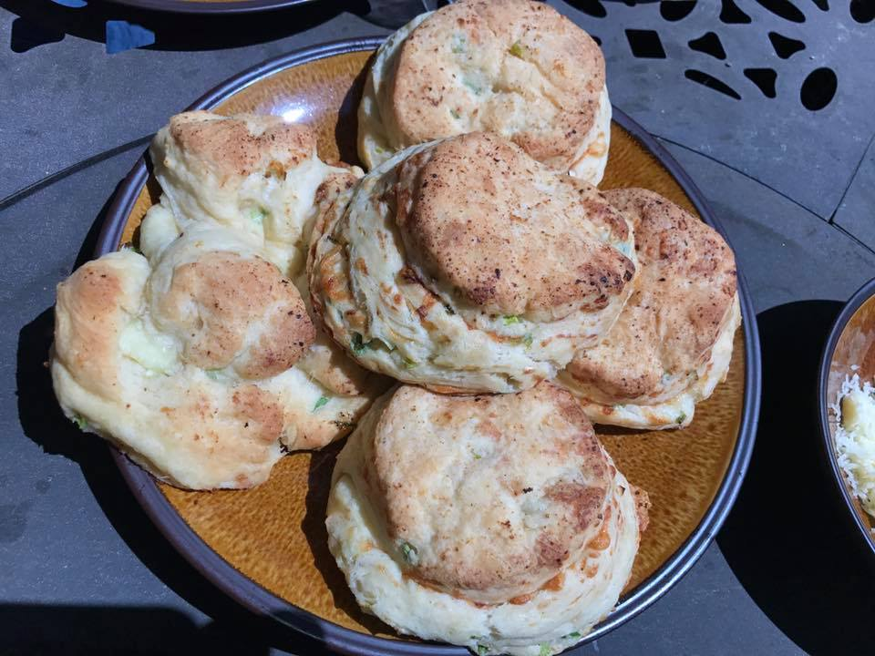 Cheddar and scallions buttermilk biscuits with a sausage grav